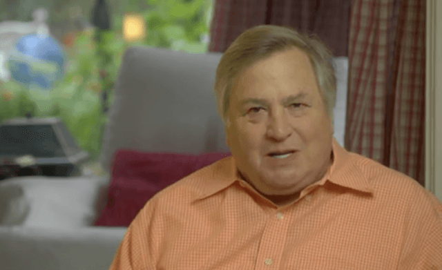 Dick Morris sits in a living room.