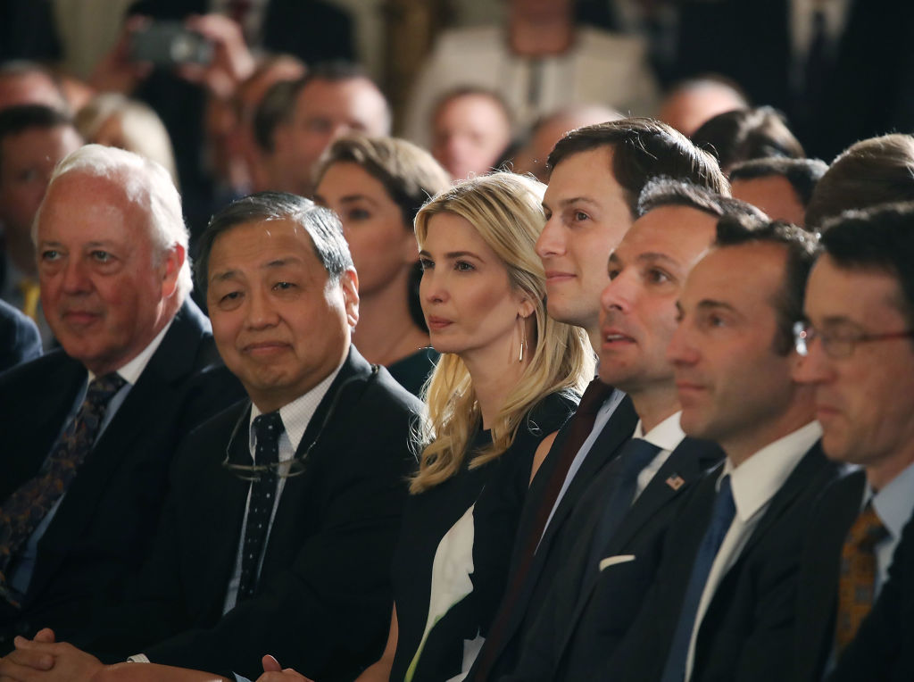 White House Senior Adviser Jared Kushner and his wife Ivanka Trump sit with guests