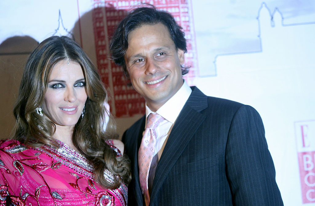 British model and actress Elizabeth Hurley (L) and her husband, Indian businessman Arun Nayar