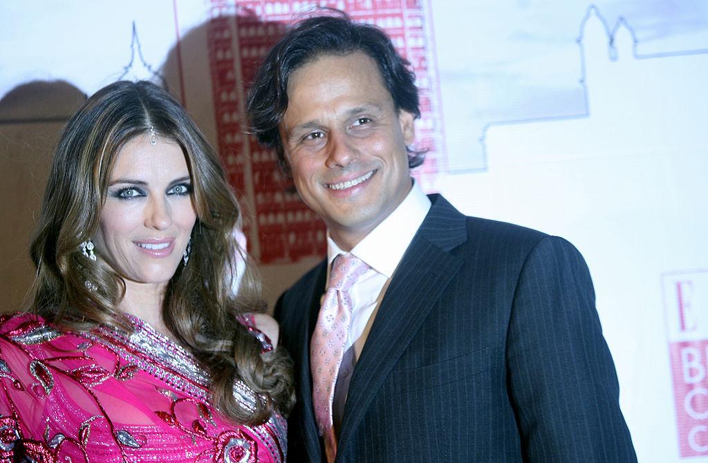 British model and actress Elizabeth Hurley (L) and her husband, Indian businessman Arun Nayar