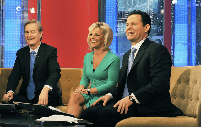 The Fox & Friends anchors sit on a brown couch.
