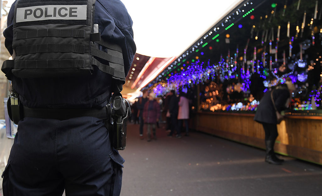 A police officer patrols on the Christmas market