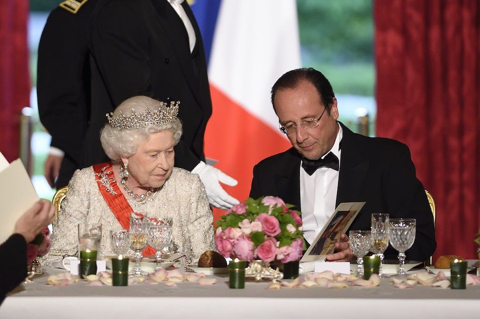 Britain's Queen Elizabeth and French President Francois Hollande attend a state dinner at the Elysee presidential palace in Paris