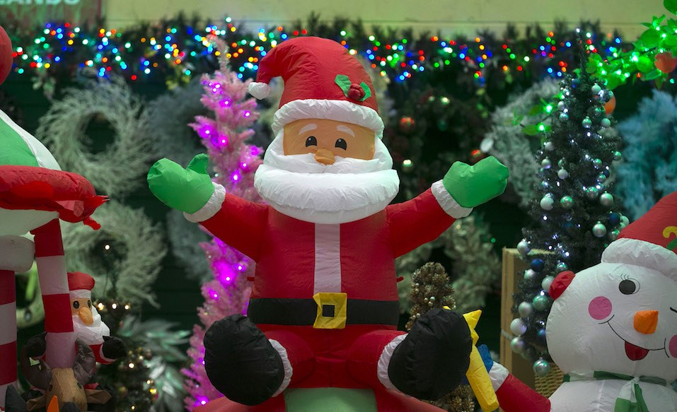 A inflatable Father Christmas is seen in the seasonal retail factory outlet