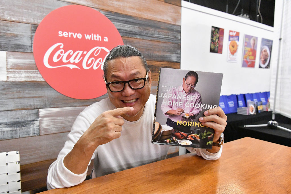 Chef Masaharu Morimoto signs his cookbbook 'Japanese Home Cooking'
