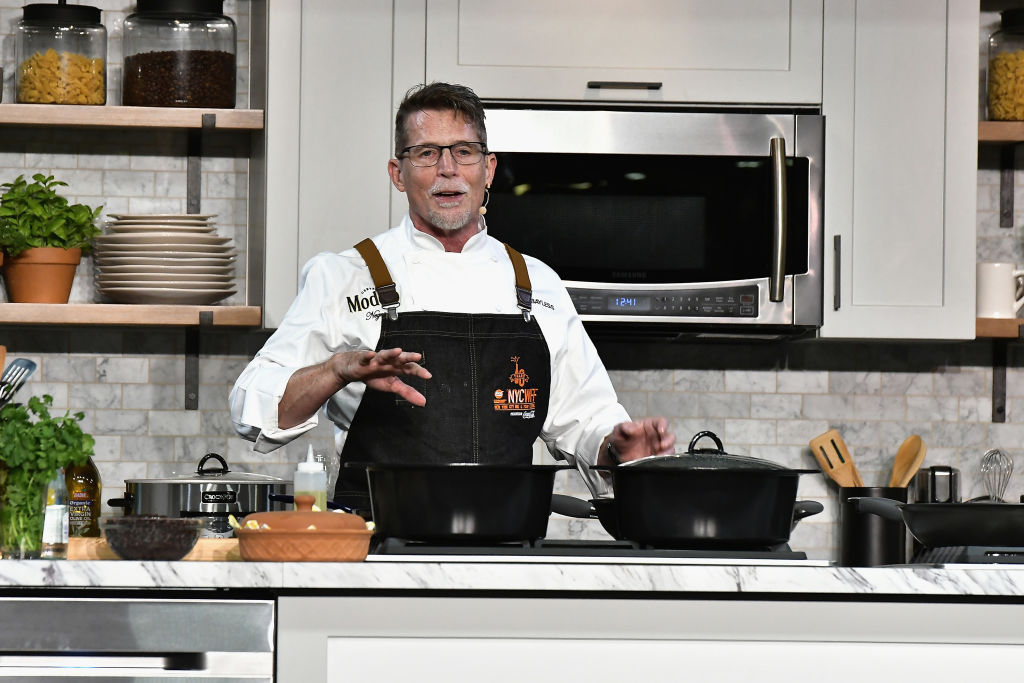 Chef Rick Bayless prepares a dish at the Food Network & Cooking Channel New York City Wine & Food Festival