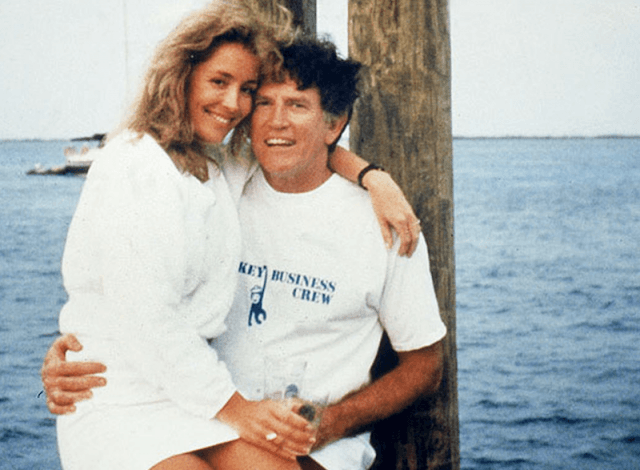 Gary Hart and Donna Rice sit on a yacht.