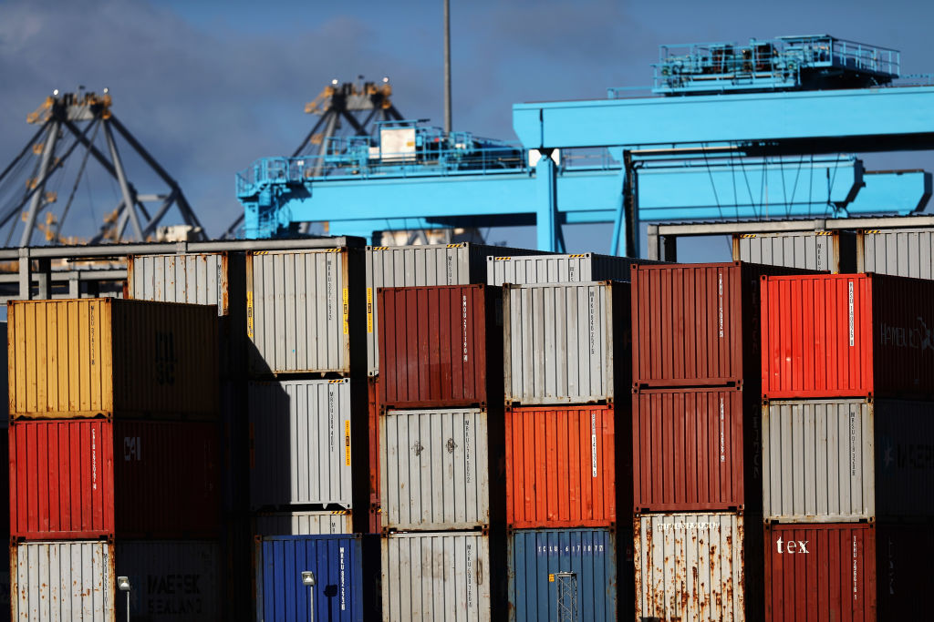 Shipping containers and cranes which move them at the Port of Rotterdam