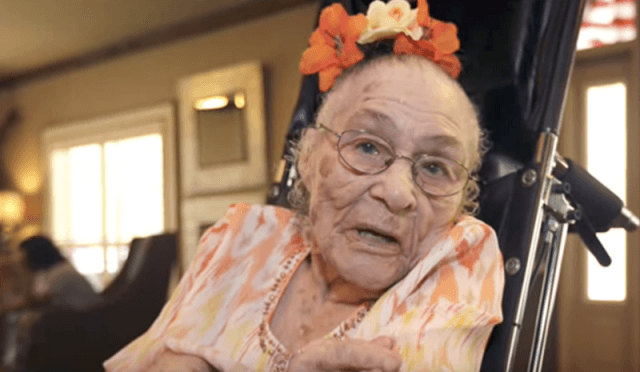 Gertrude Weaver sitting on a wheel chair.