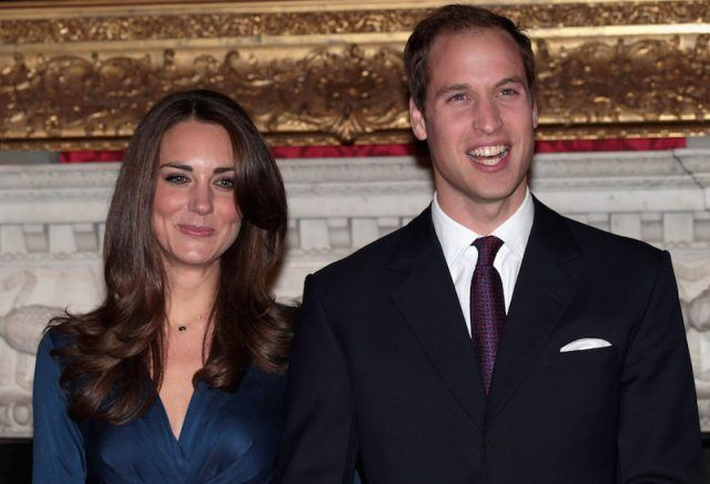 Kate Middleton and Prince William posing and smiling together.