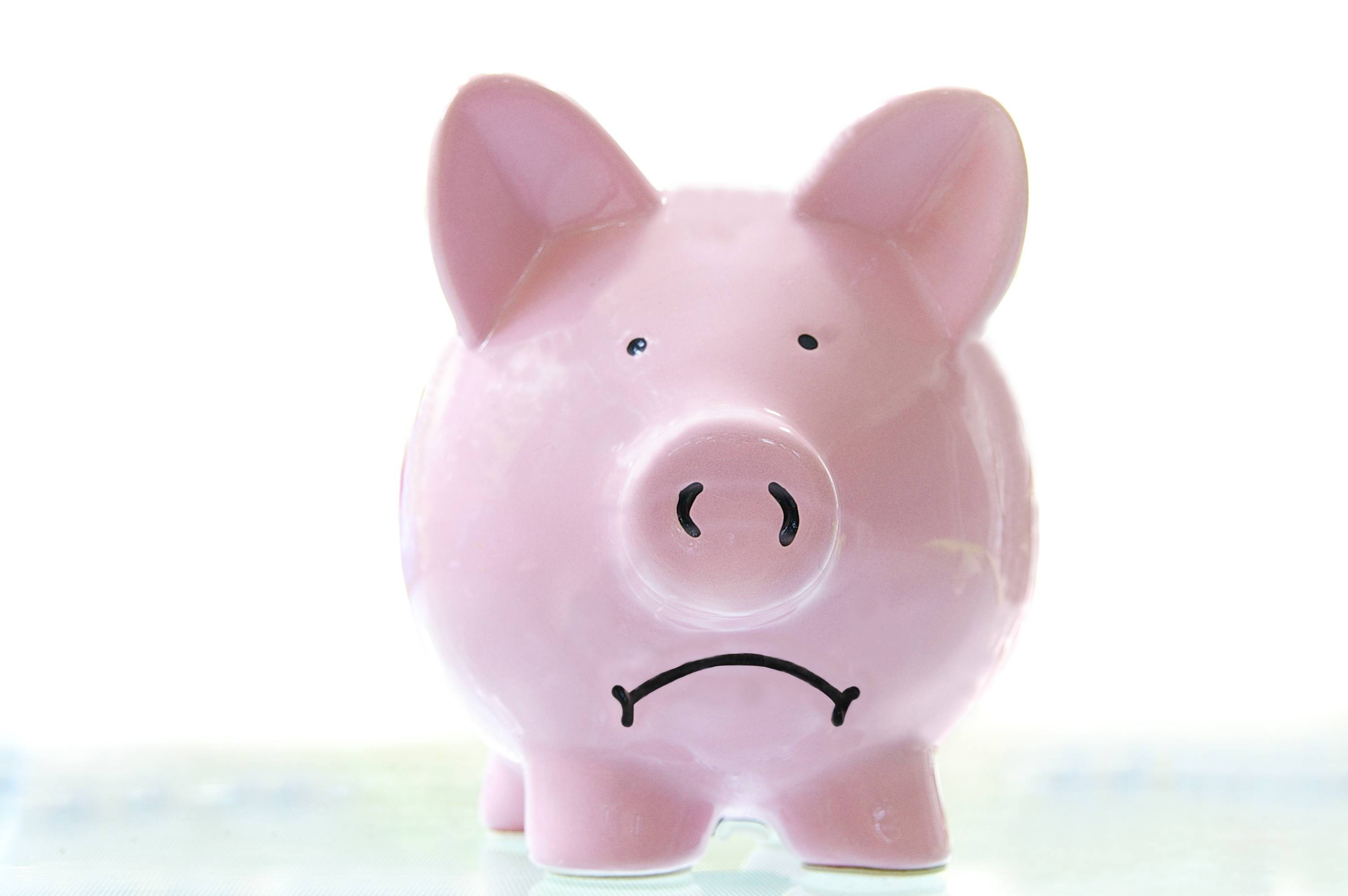 frowning piggy bank