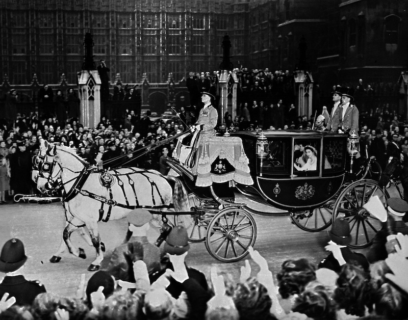 Queen Elizabeth and husband Prince Philip are cheered by the crowd after their wedding ceremony.