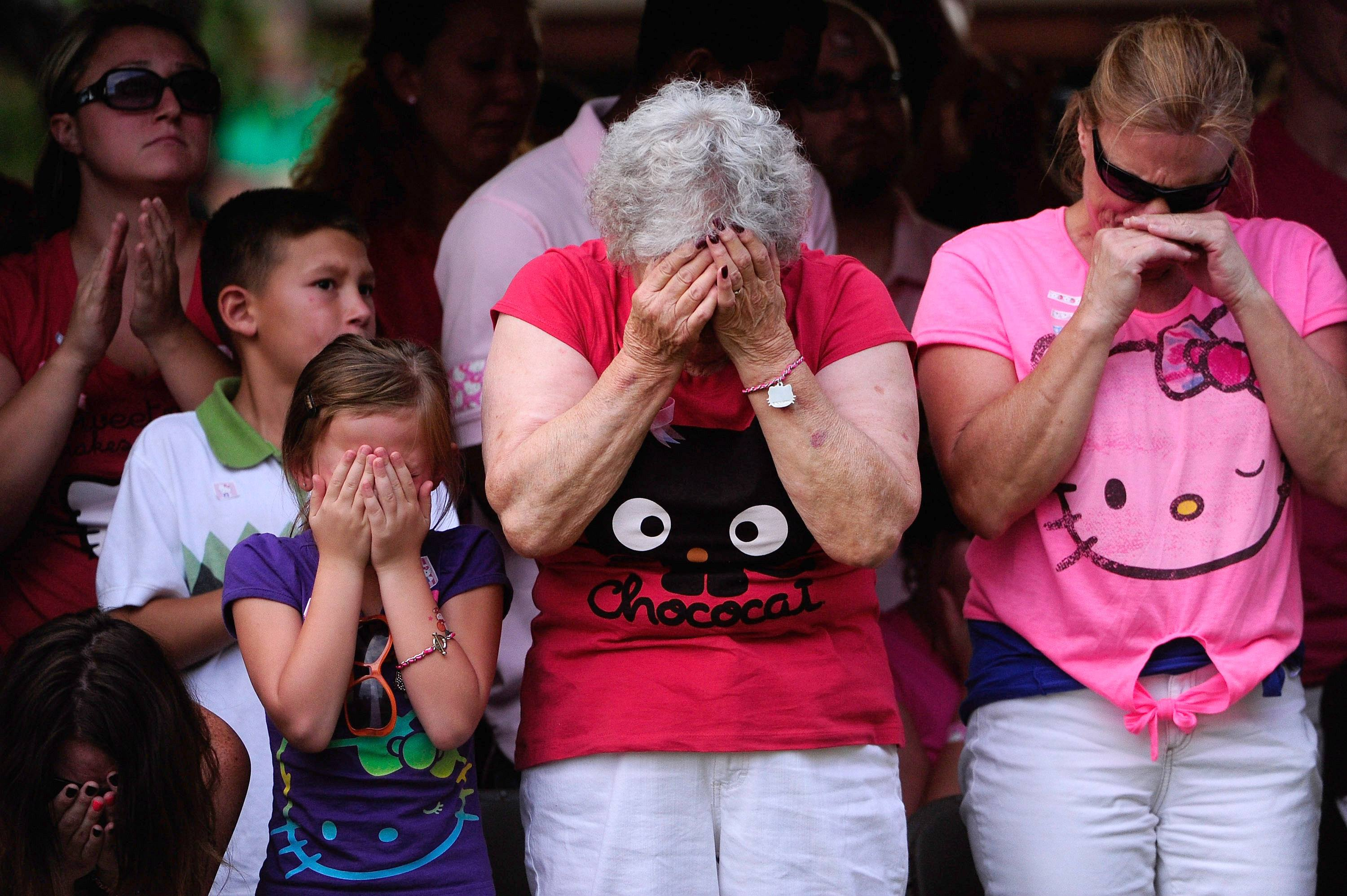 family members of colorado shooting victims cry