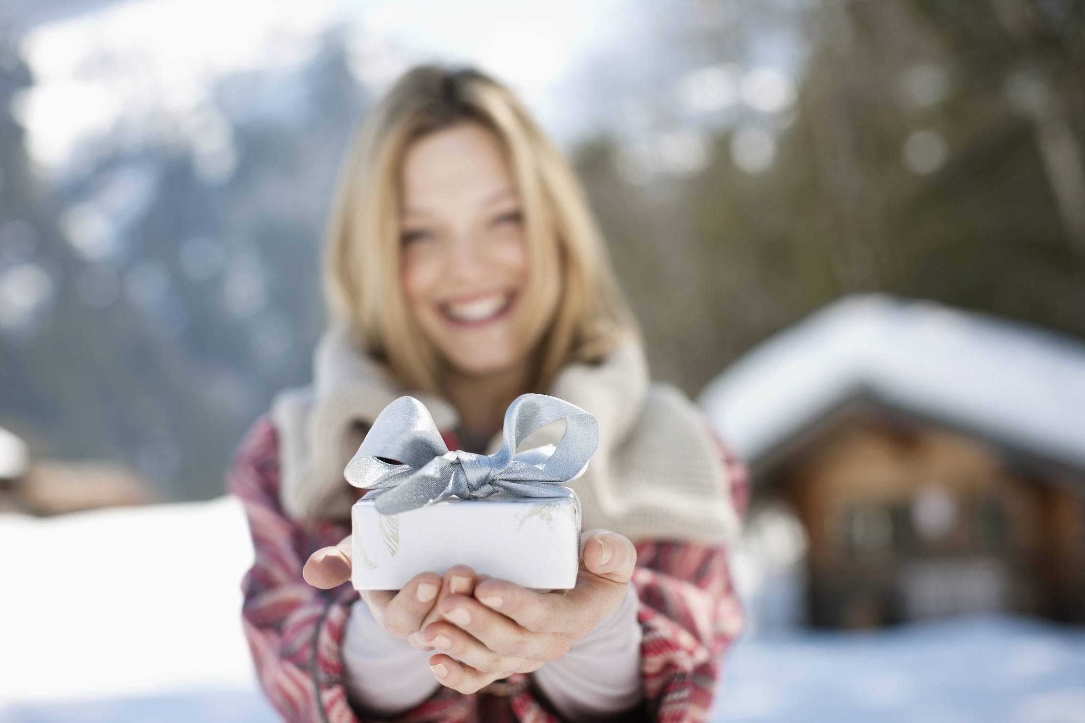 woman holding up a gift