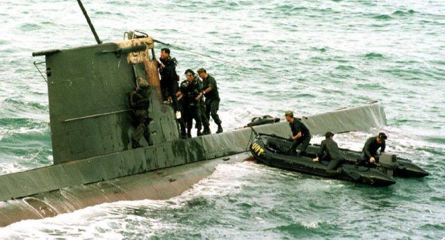 South Korean marine corps search a North Korean combat-class submarine after its discovery on the northeast coast of South Korea some 20 Kilometers south of the demilitarized zone