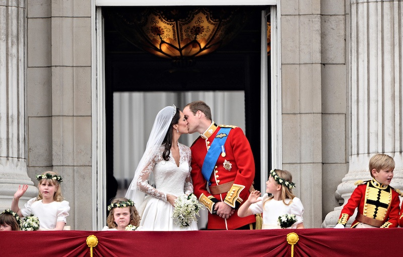 Britain's Prince William kisses his wife Kate, Duchess of Cambridge, on the balcony of Buckingham Palace,
