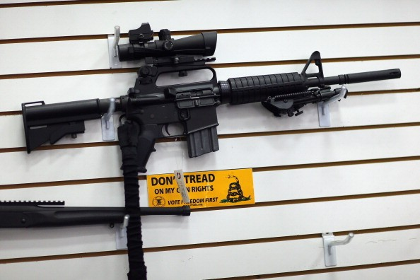 an AR-15 on the wall at a gun store.