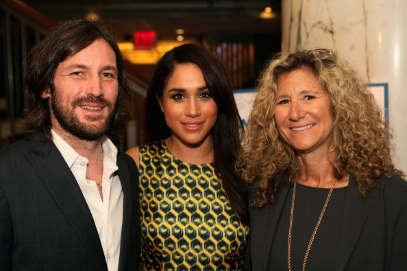 meghan markle (center) with friends at a charity event