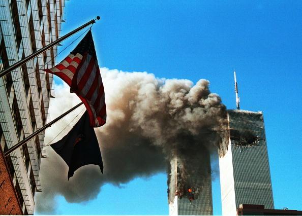 american flags flying in front of the world trade center on 9/11/01