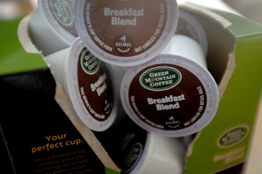 a box of K-Cups open and spilling out the cups