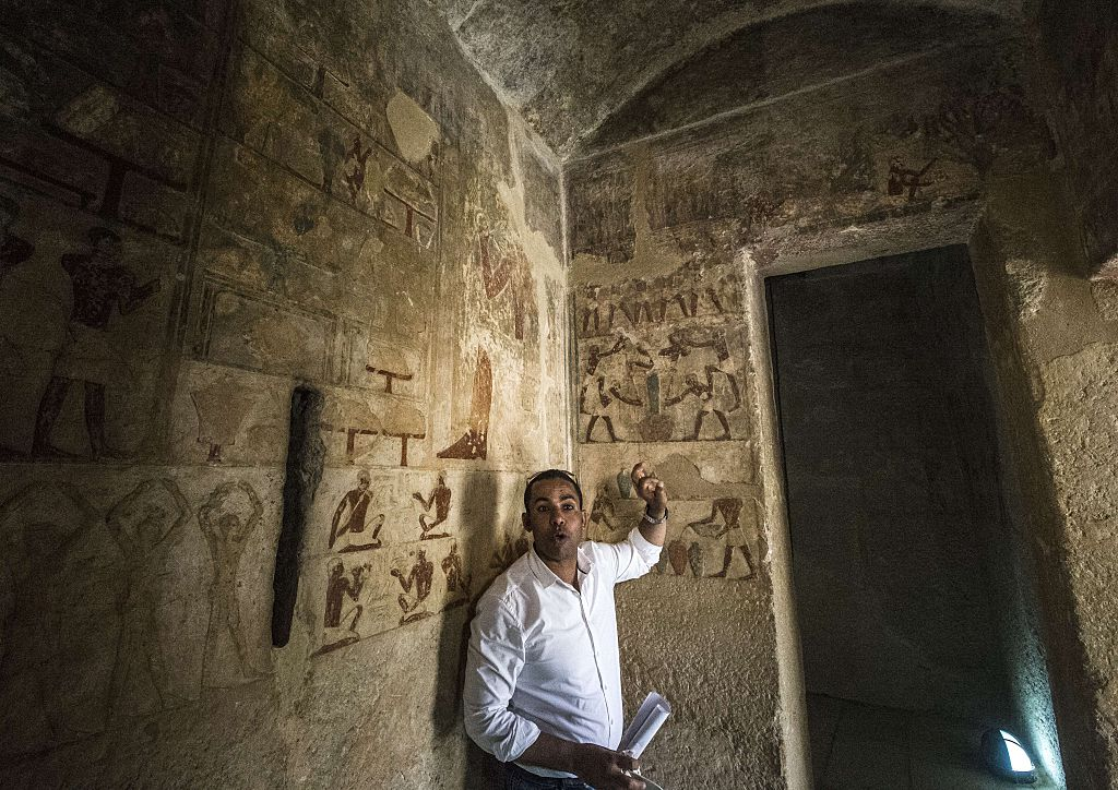 an Egyptologist inside one of the great pyramids