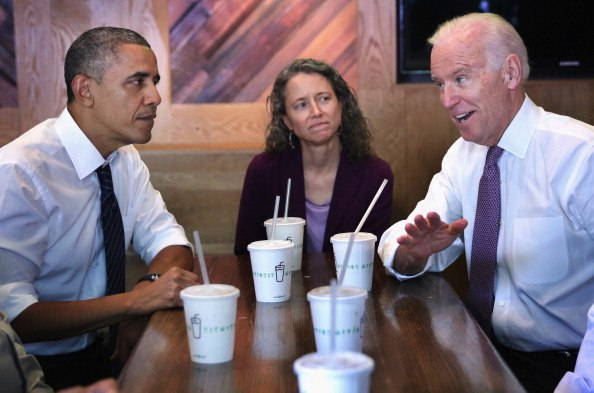 joe biden and barack obama at a diner with paper cups