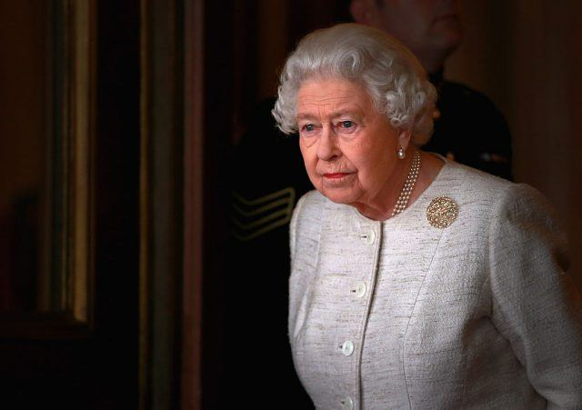 Queen Elizabeth at buckingham palace in white.