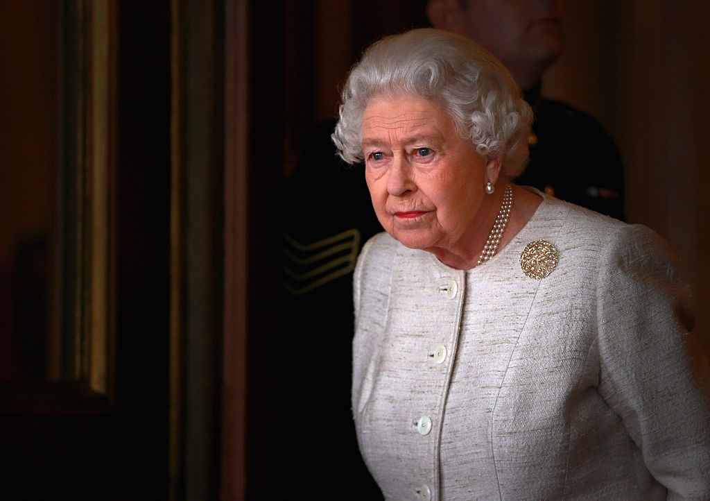 queen elizabeth at buckingham palace in white