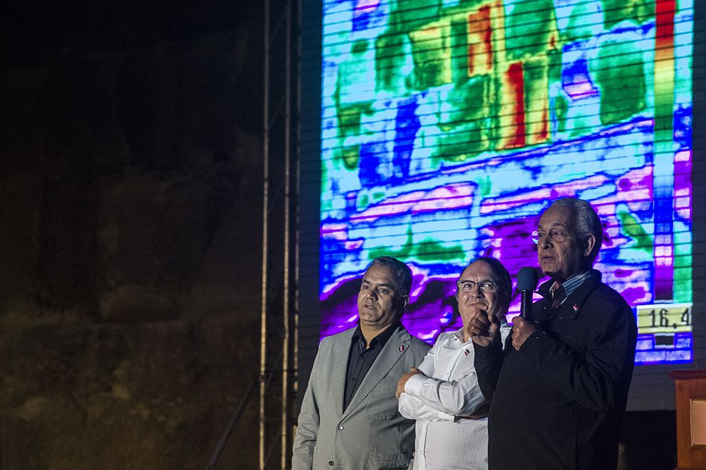 three scientists in front of an infrared screen