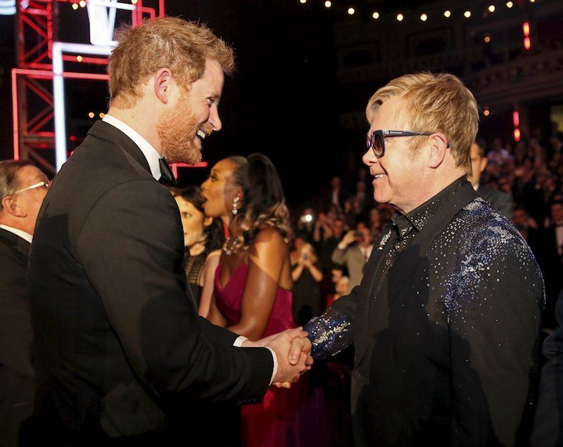 Prince Harry greets Elton John after the Royal Variety Performance at the Albert Hall