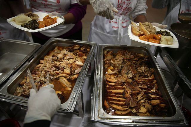 Volunteers serving thanksgiving day meals