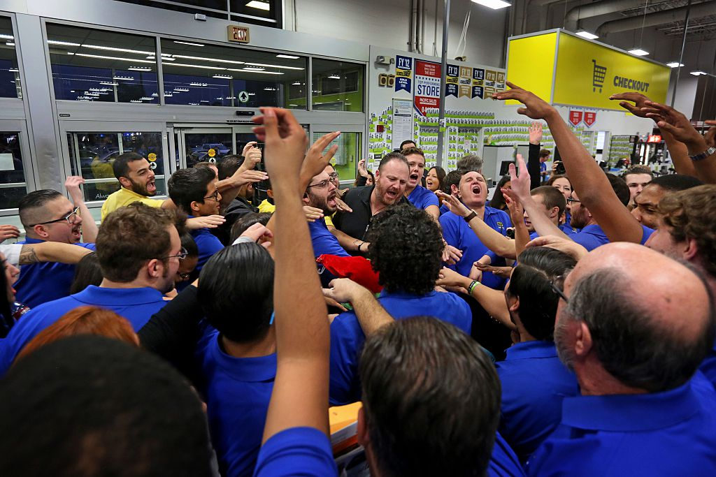 Best Buy employees do a group cheer before Black Friday