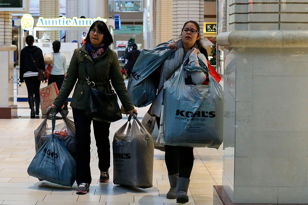 shoppers carry bags during Black Friday