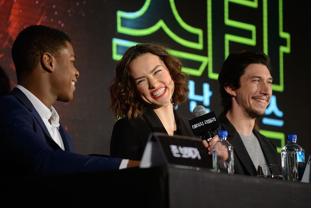 John Boyega, Daisy Ridley, and Adam Driver doing press for Star Wars: The Force Awakens