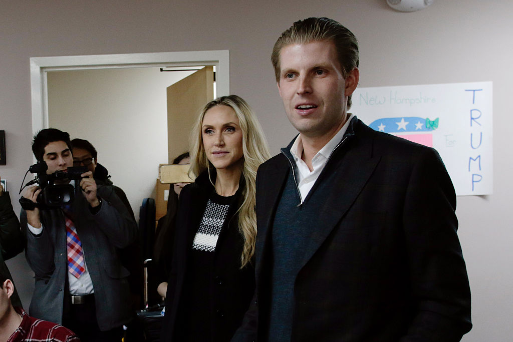Eric and Lara Trump speaking to cameras