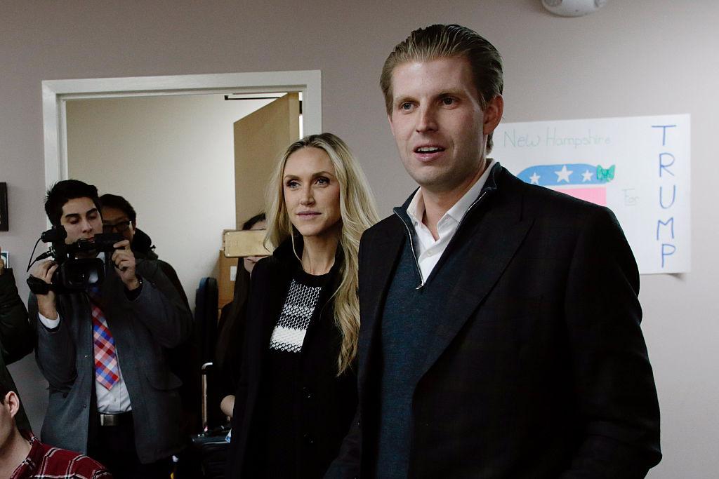 Eric and Lara Trump speaking to cameras
