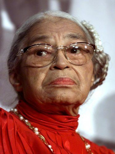 "WASHINGTON, : Civil rights heroine Rosa Parks attends the opening of ""Marching Toward Justice: The History of the 14th Amendment of the US Constitution"" ribbon cutting ceremony at the Thurgood Marshall Federal Judiciary Building, in Washington, DC, as part of Black History month. (ELECTRONIC IMAGE) AFP PHOTO Paul J. RICHARDS (Photo credit should read PAUL J. RICHARDS/AFP/Getty Images)"