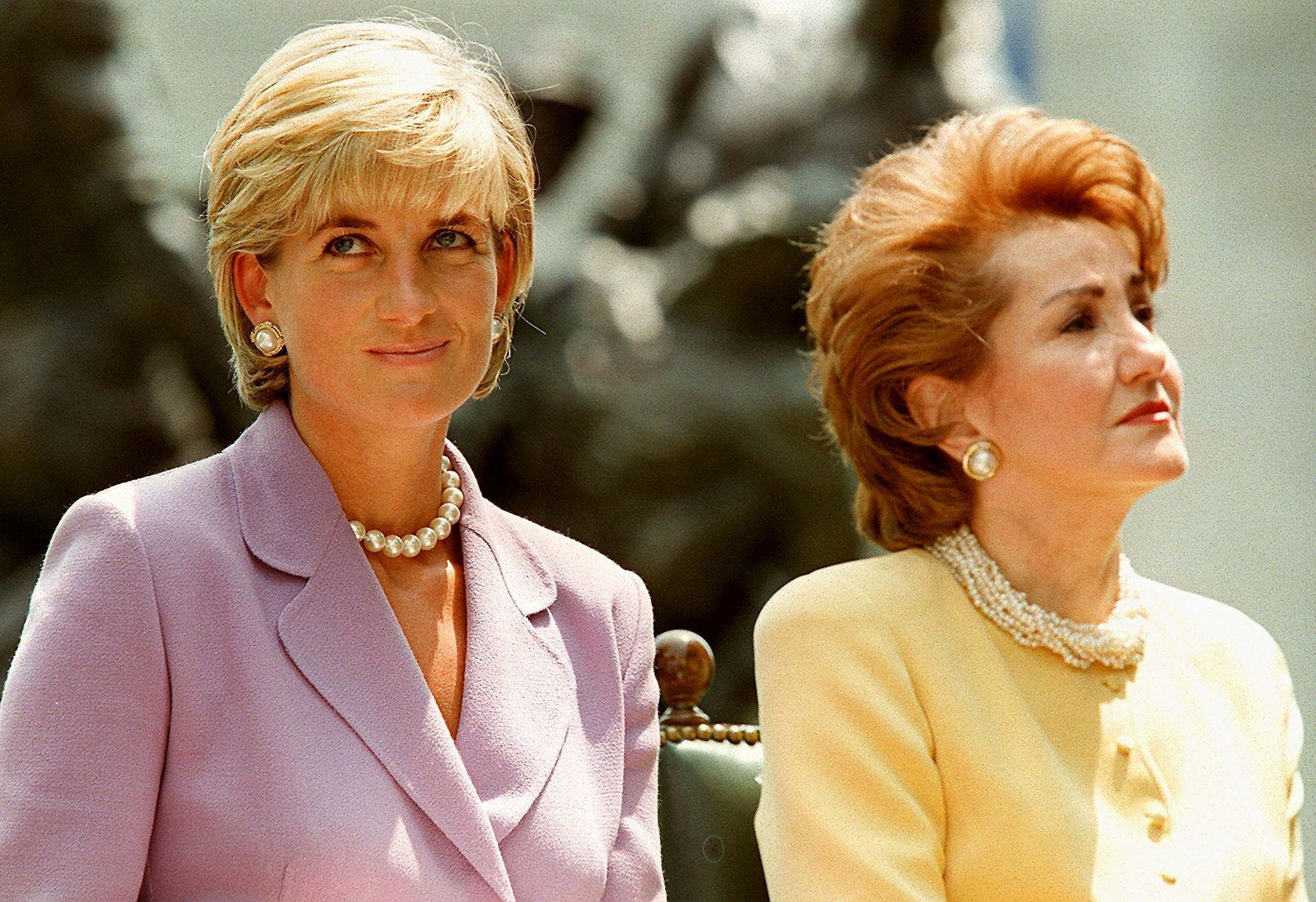 princess diana in a purple blazer next to elizabeth dole in a yellow one