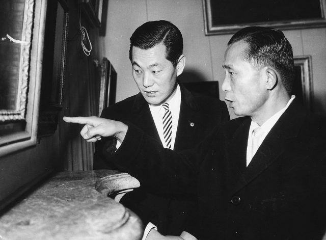 Chung Hee Park, President of South Korea (right), points to a painting of Castle Schleissheim as his interpreter looks on, Germany, circa 1965.