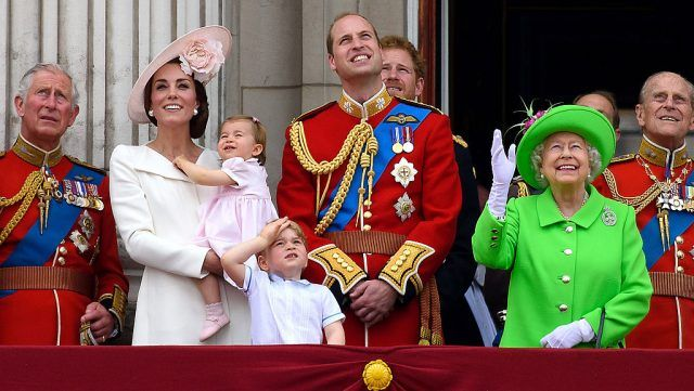The british royal family in formal dress at a state function.