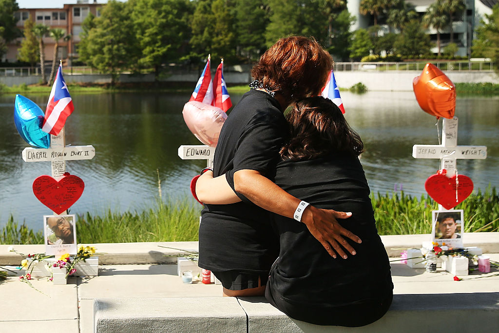 two women hung by the water and a Pulse shooting memorial