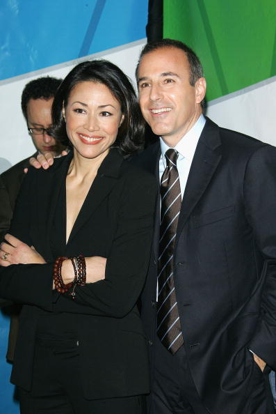 ann curry and matt lauer pose together, both in black