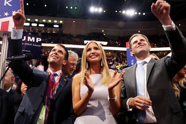 Trump Jr, Ivanka, and Eric Trump cheering on their father.
