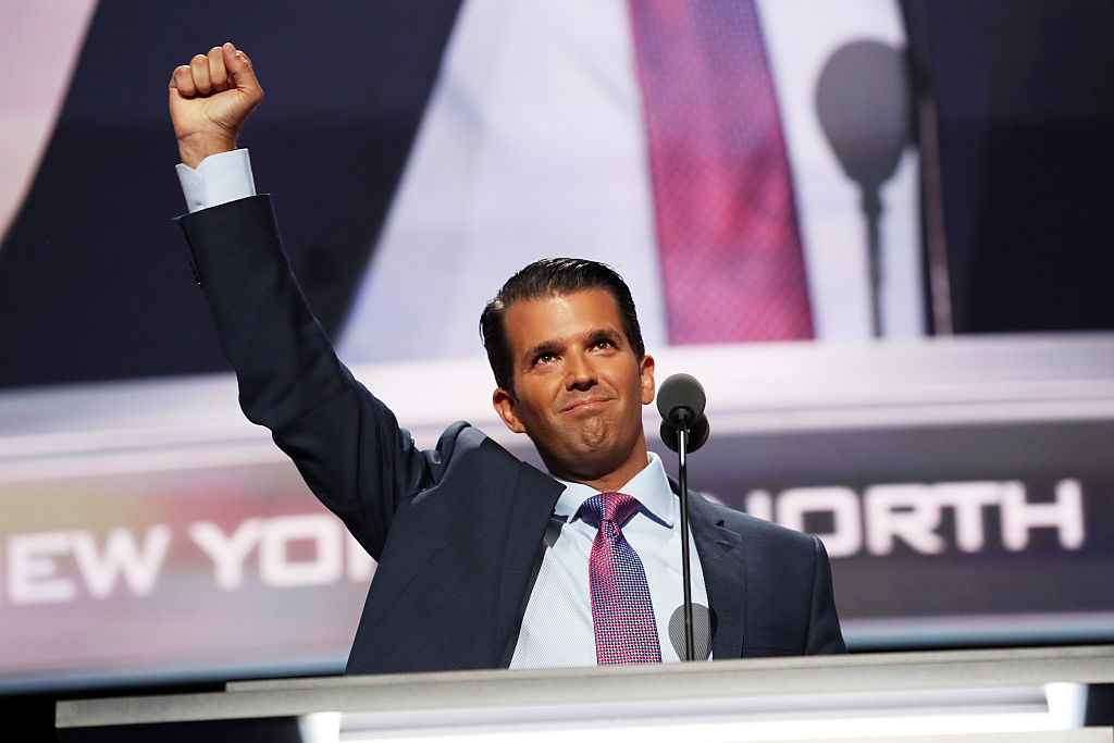 donald trump jr in a purple tie with his fist raised