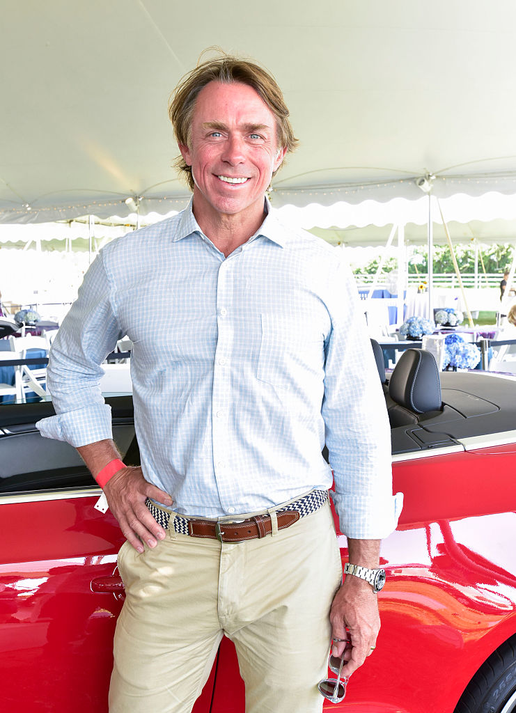 john besh with a red car