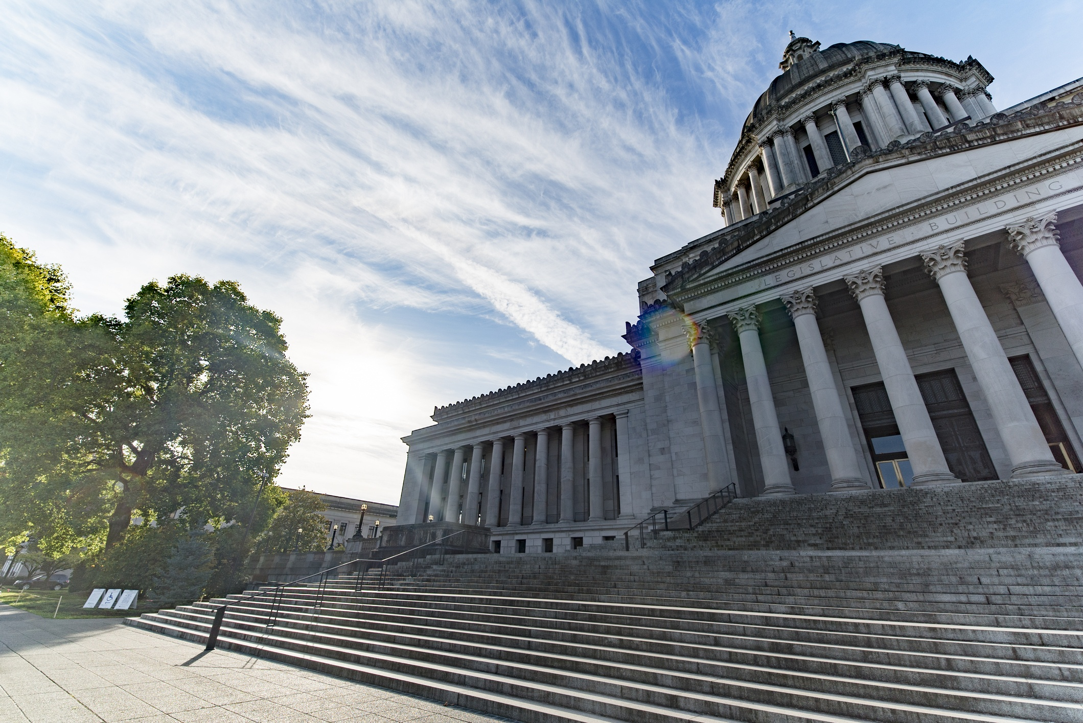 The Washington State Capitol building under a partly cloudy sky