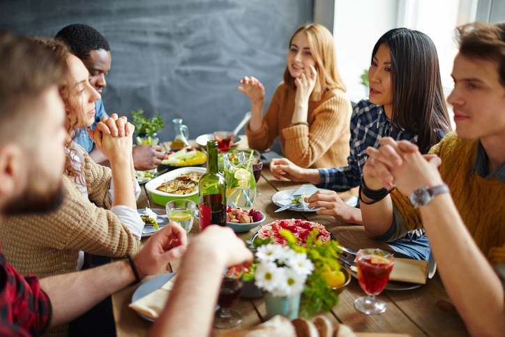 Group of intercultural friends having Thanksgiving dinner