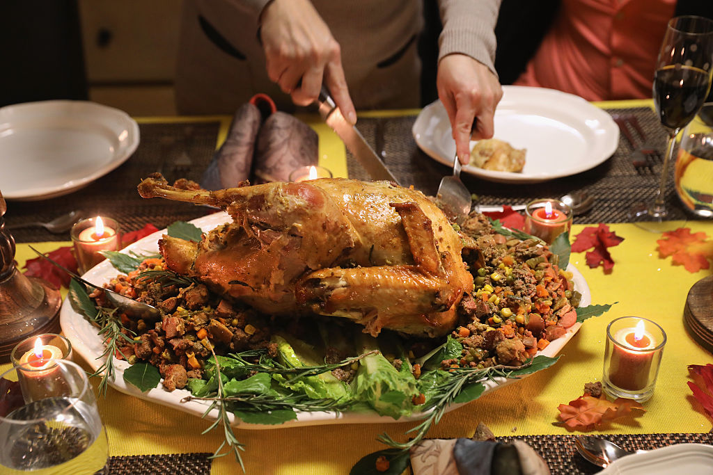 a thanksgiving turkey being carved