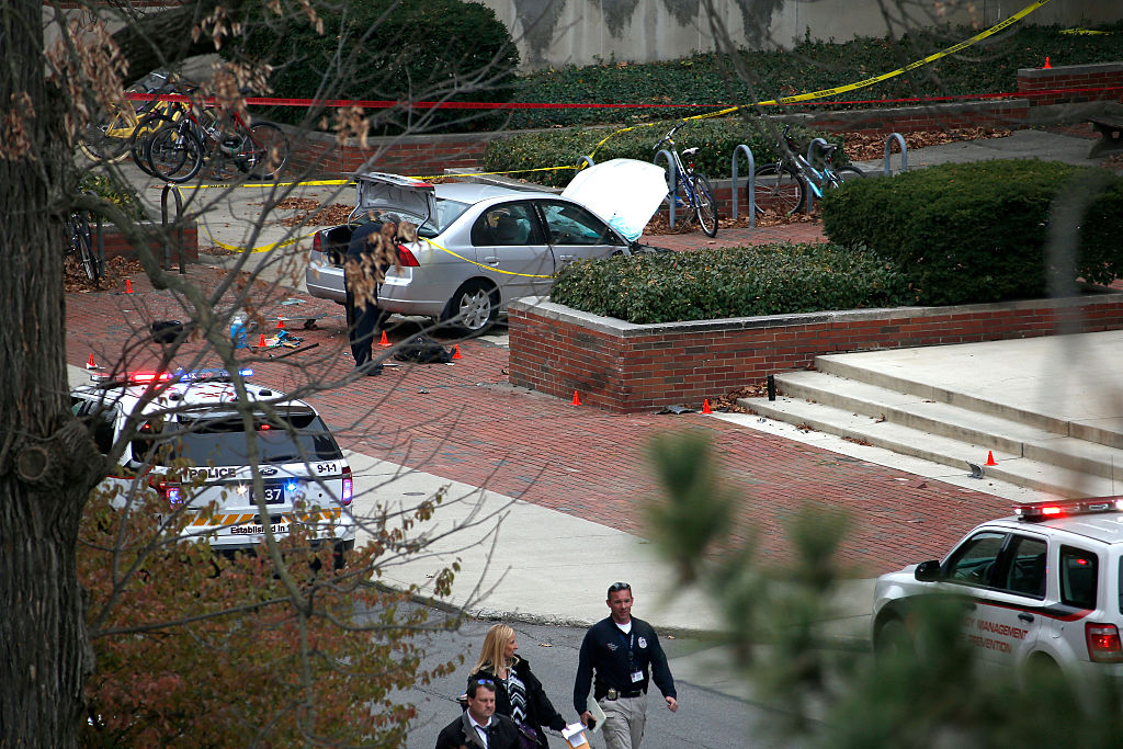 the scene of an Ohio State terrorist attack with a silver car and police tape