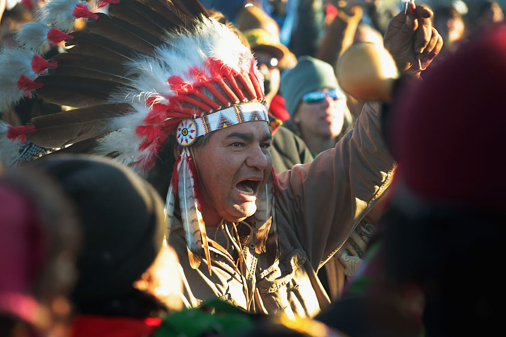 a native american chief yells at standing rock